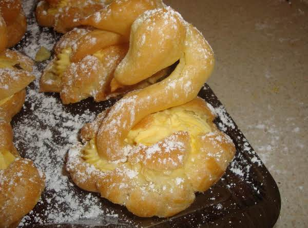 Delicious And Beautiful Cream Puff Swans With A Creamy Mousse Filling