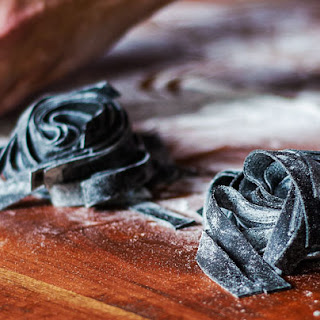Squid-Ink Tagliatelle with Nduja and Clams.