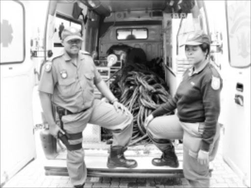 RETRIEVED: Cops show stolen cables found stashed in an ambulance. 28/02/2010. © Unknown.