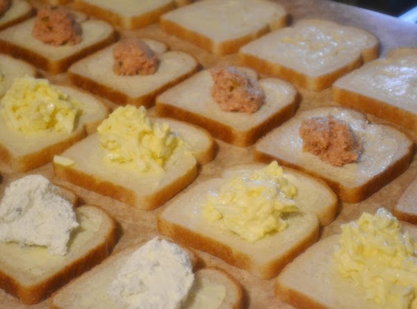 Divide the ham mixture evenly among the 2nd row of prepared wheat bread. ...