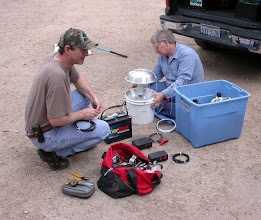 Photo: Prepping a bucket light trap.