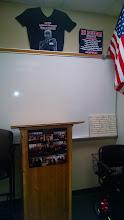 Photo: My podium, which I try to put pictures on of students from the past.