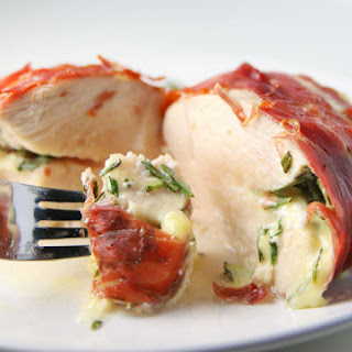 Prosciutto Wrapped Chicken Stuffed with Brie and Rosemary.