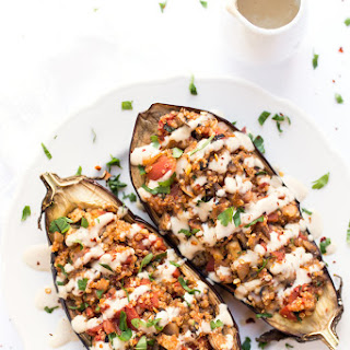 Quinoa Stuffed Eggplant with Tahini Sauce.