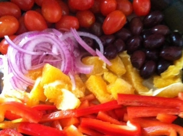Slice the onion,Red bell peppers,and cut the oranges in to slices. Remove all traces...