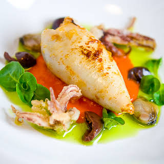 Stuffed Squid with Chorizo, Piquillo Pepper, Black Olives & Basil Oil.