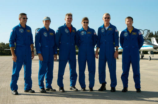 After their arrival at KSC's Shuttle Landing Facility poses for a photo.