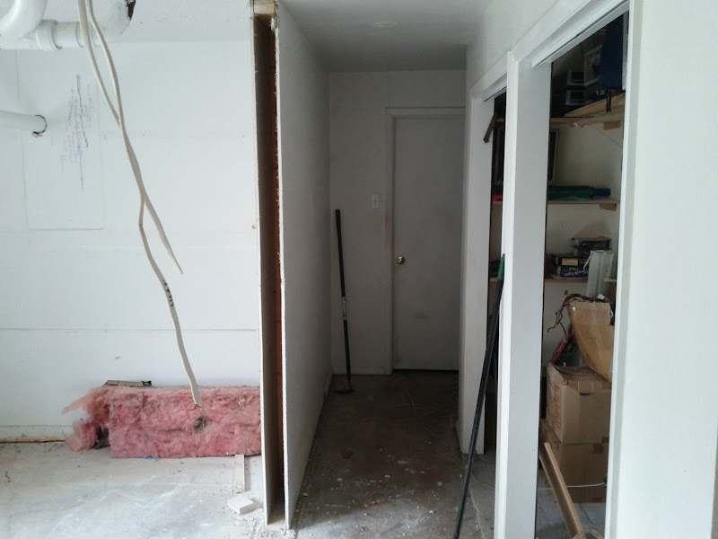 Photo: This use to be a hallway leading to my office.  The space to the right was pretty much storage, but wasted space.  Now it will open and used for my shop.
