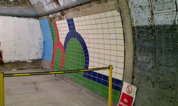 Photo: The disused tunnel has been used for a number of things, including experimental tiling. Piccadilly Circus, anyone?