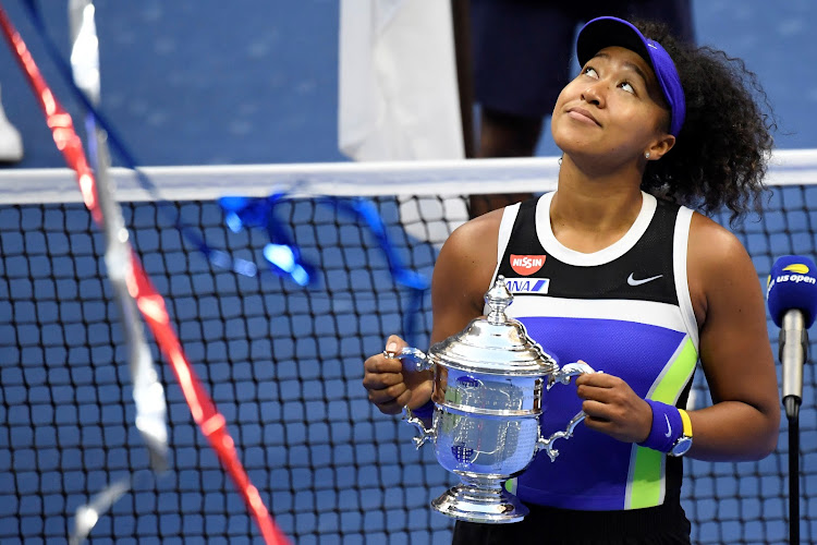 Naomi Osaka of Japan celebrates with the championship trophy after her match against Victoria Azarenka of Belarus (not pictured) in the women's singles final on day thirteen of the 2020 U.S. Open tennis tournament.