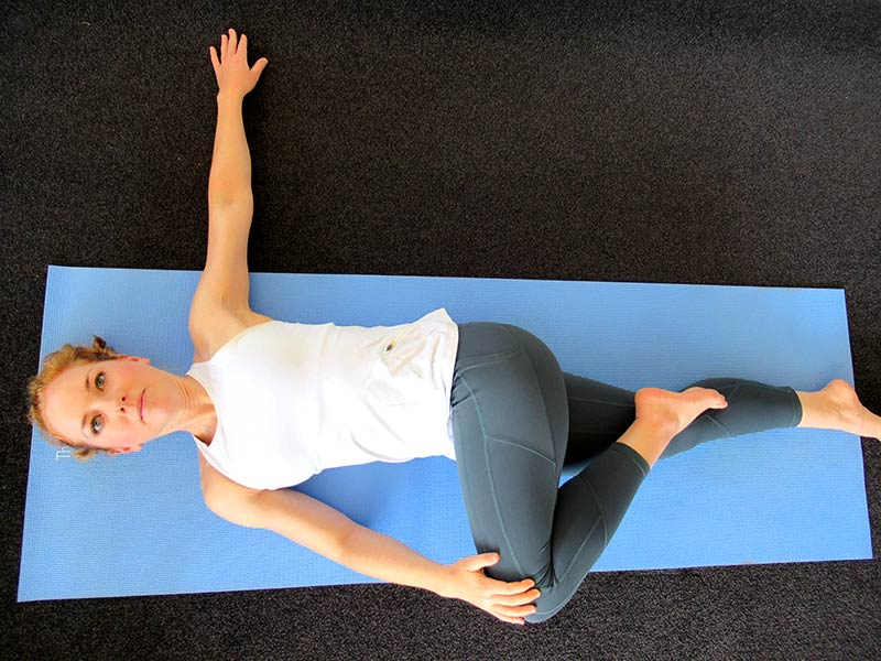 Spinal twist yoga pose for stress relief