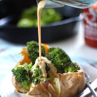 Garlic Roasted Broccoli Stuffed Potatoes with Tahini Cheese Sauce.