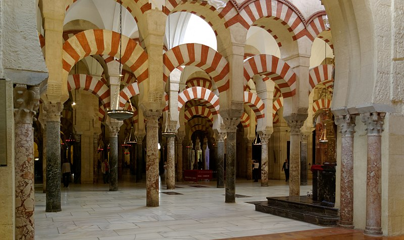 Arches on the interior of the former Mosque (now cathedral) of Cordoba, with red and white banded stone.