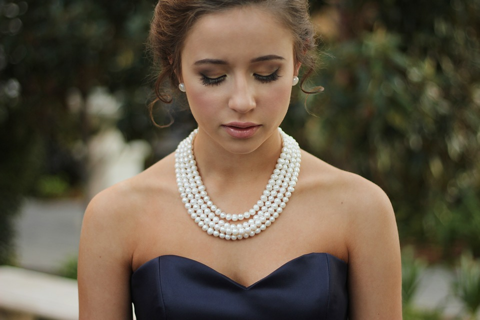 Woman with Pearl Necklaces