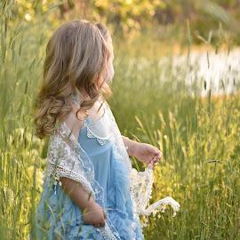 Gazing at the Water by Nicole Ferris - Babies & Children Children Candids ( dress, sunlight, toddler, green, blue, outdoors, candid, grass, water )