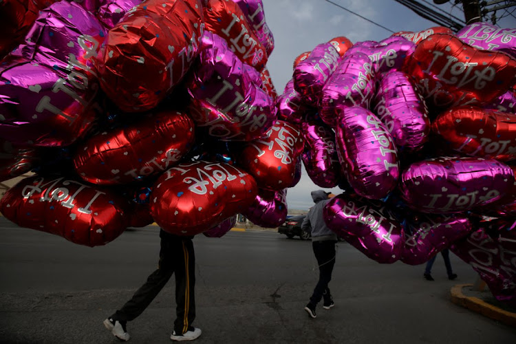 Street vendors carry heart-shaped balloons on Valentine's day in Ciudad Juarez, Mexico, on February 14, 2019. But, like sexist advertising at this time of year, not all offerings are palatable. Picture: REUTERS/JOSE LUIS GONZALEZ