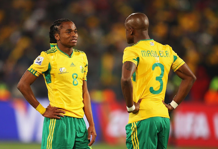 Siphiwe Tshabalala and Tsepo Masilela of South Africa are dejected after defeat in the 2010 FIFA World Cup South Africa Group A match between South Africa and Uruguay at Loftus Versfeld Stadium on June 16, 2010 in Tshwane/Pretoria, South Africa.