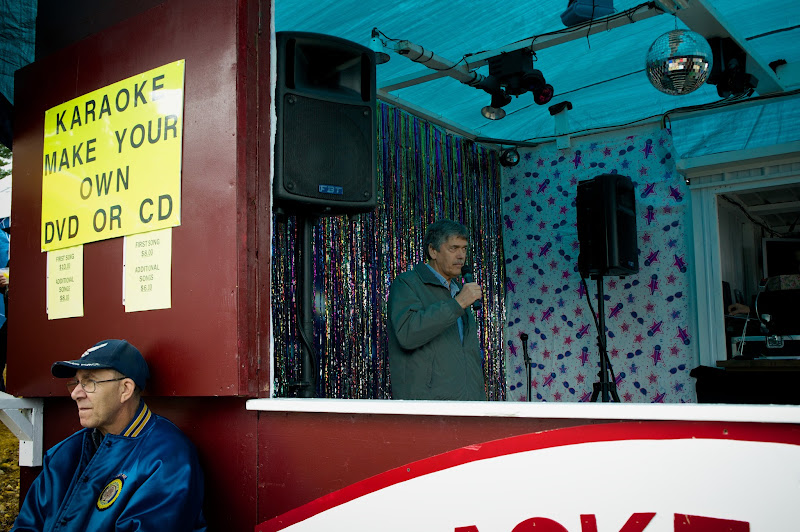 Photo: Man recording in a nostalgic and somewhat sad Karaoke booth on wheels at the Deerfield Fair.
