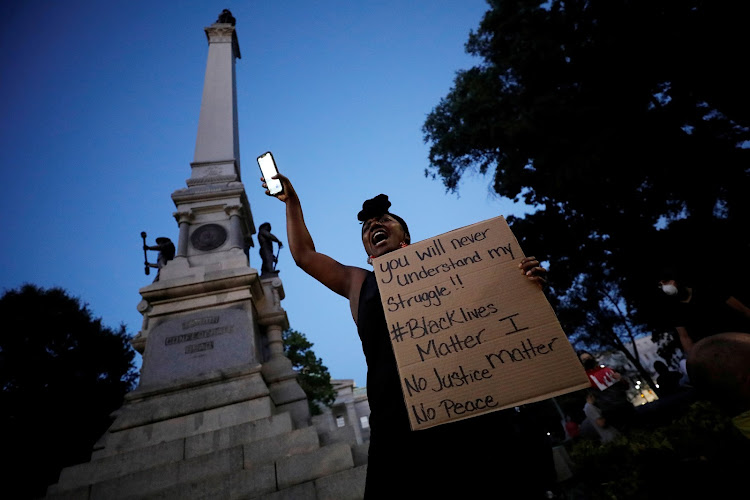A protester speaks to the crowd underneath a Confederate monument during nationwide unrest following the death in Minneapolis police custody of George Floyd, in Raleigh, North Carolina, US.