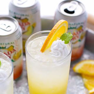 Orange Creamsicle Cocktail With Whipped Coconut Cream.