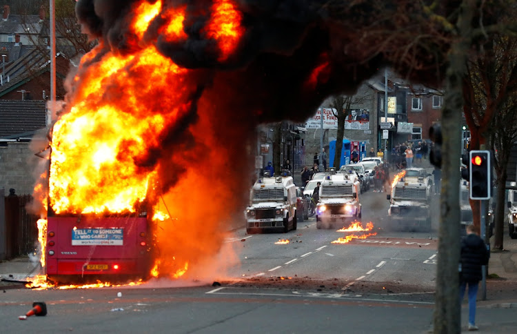 A hijacked bus burns on Shankill Road as protests continue in Belfast, Northern Ireland, April 7 2021. Picture: REUTERS/JASON CAIRNDUFF