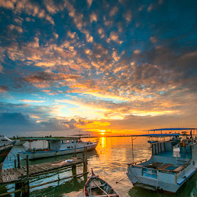 boat in the middle by Andy R Effendi - Landscapes Sunsets & Sunrises