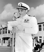 Photo: Capt. Duffy reads the Navy directive ordering him to take command of NAAS Chase Field