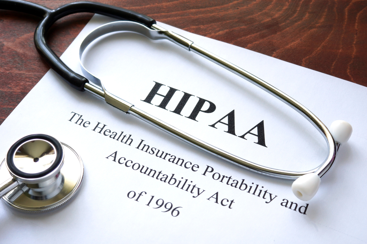 HIPAA violation costs, as highlighted by the paperwork in this photos, are just one reason why healthcare organizations benefit from cybersecurity and IT services for doctors.