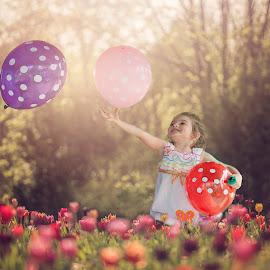 Blooms and Balloons by Sandra Hilton Wagner - Babies & Children Children Candids ( flowers, outdoors, candid, balloons, happy, girl, fields, summer, child, joyful )