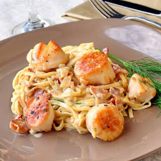 Pan Seared Scallops with Fettuccine in Bacon Fennel Cream Sauce.