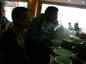 Photo: last breakfast feature southern China cuisine offered by kid brother couple, with their 2 kids. here woz and his uncle.