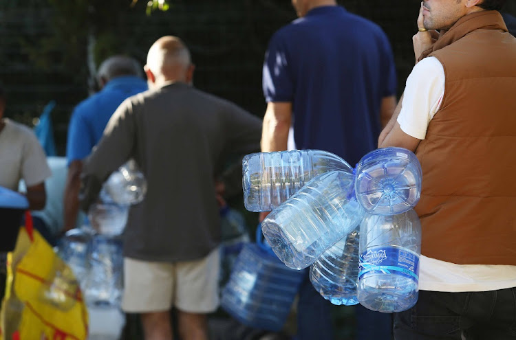 Residents queue in Newlands for drinking water from a spring. Picture: THE TIMES/ESA ALEXANDER