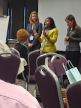 Photo: M.S. student Raquel Teasley introduces her poster at the 2012 National Center for Food Protection and Defense Conference