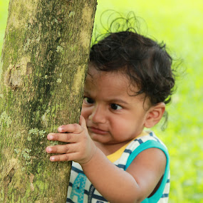 Concentrate...Hold strong and Save the Tree !!! by Aarthi Siva - Babies & Children Children Candids ( canon babies babies candid, cute baby, tree, nature, green, nature up close, nice try, cute expression )