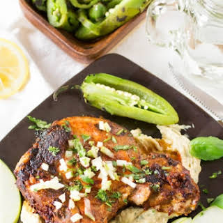 Baked Pork Chops Over Cheesy White Bean Puree –.