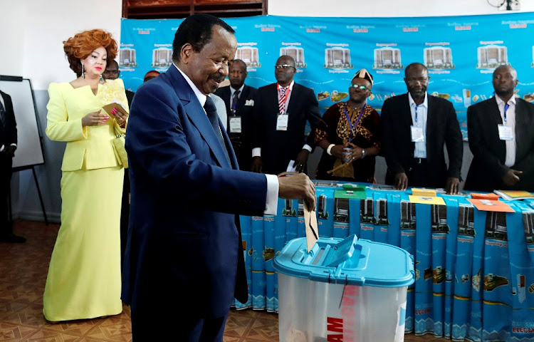 Cameroonian President Paul Biya casts his ballot while his wife, Chantal, watches during the presidential election in Yaounde, Cameroon, October 7 2018. Picture: REUTERS/ZOPHRA BENSEMRA