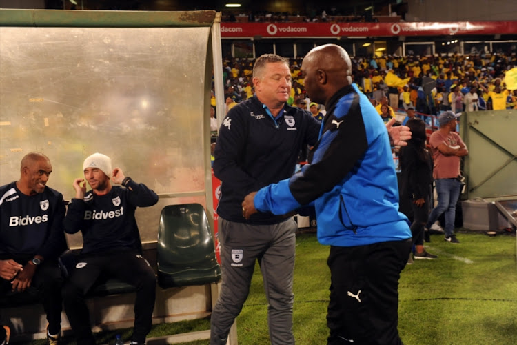 Pitso Mosimane of Mamelodi Sundowns and Gavin Hunt of Bidvest Wits team remember Mama Winnie Mandela during the Absa Premiership match between Mamelodi Sundowns and Bidvest Wits at Loftus Versfeld Stadium on April 14, 2018 in Pretoria, South Africa. (