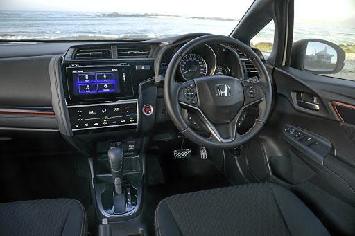 The interior of the Jazz gets a bit of sporty leather and red trim inserts. Picture: QUICKPIC