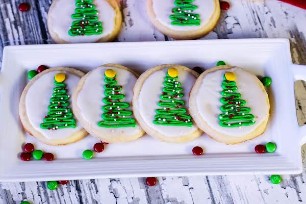 Cream Cheese Sugar Cookies Decorated With Christmas Trees.
