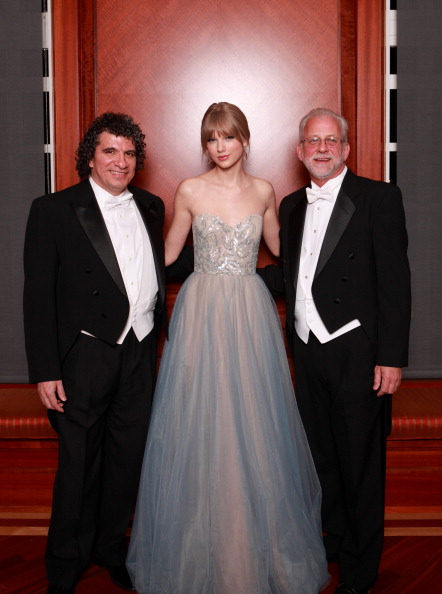 Photo: NASHVILLE, TN - DECEMBER 10: (L-R) Giancarlo Guerrero, musician Taylor Swift, and Alan Valentine attend the annual Nashville Symphony Ball at the Schermerhorn Symphony Center on December 10, 2011 in Nashville, Tennessee. Swift, a 4-time GRAMMY winner, was honored with the Nashville Symphony's prestigious Harmony Award, recognizing her for exemplifying the unique harmony between the many worlds of music that exist in Nashville, and her significant contributions to the development and appreciation of musical culture. Earlier this month Swift was feted by Billboard magazine as their 2011 Woman of the Year, the youngest artist ever to receive this top honor. Last month she won Artist of the Year at the American Music Awards and was named Entertainer of the Year by the Country Music Association. (Photo by Royce DeGrie/Getty Images)