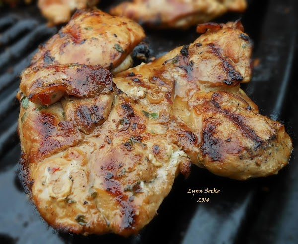 Allow chicken to rest, then slice in strips and cut strips in half. ...