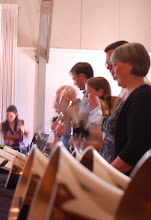 Photo: Requirement 2 (foreground blur): This photo captures the constant action of a handbells concert. All bell ringers were playing, and the slow shutter speed (1/4) allowed the action to be captured as a motion blur.
