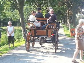 Photo: Links burgemeester Van Ruijven in het rijtuig en rechts Jaap Zwart.