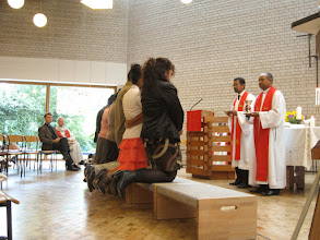 Photo: Malagasy church members receive communion.