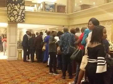 Guests await the start of a book launch by controversial pastor Prophet Shepherd Bushiri in Johannesburg.