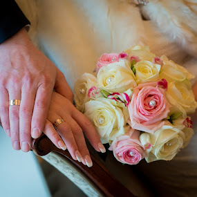 Hands and rings with beautiful wedding bouquet by Bartas Mi - Wedding Details ( bouquet, jewelry, husband, romance, together, honeymoon, love, hand, girl, married, life, partners, hands, woman, family, couple, rings, gold, bride, flowers, flower, man, greeting, diamonds, white, ceremony, marriage, human, bridal, wedding, roses, matrimony, celebration, groom, floral )