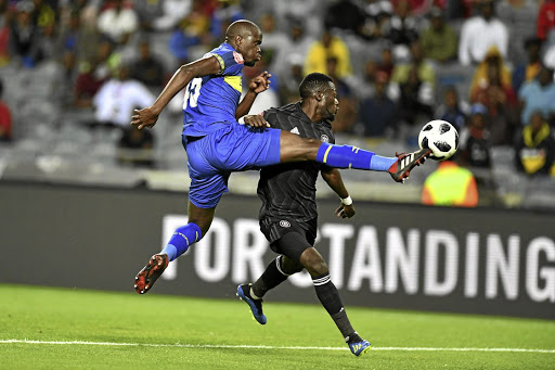 Kwanda Mngonyama of Cape Town City wins the ball ahead of Pirates' Augustine Mulenga during their Absa Premiership match at Orlando on Thursday.