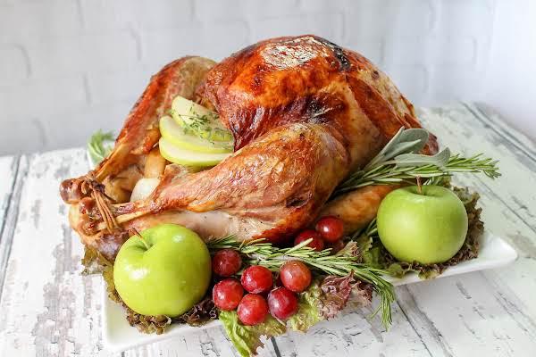 Apple And Herb Infused Roast Turkey On A Platter.