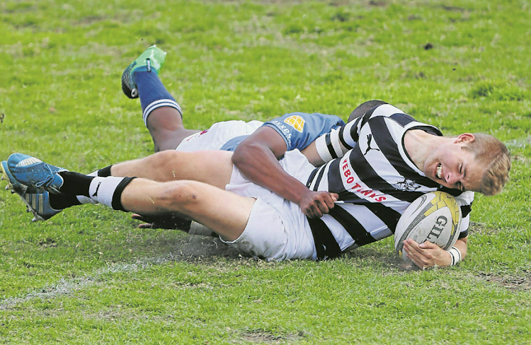 Selborne College's James Flanagan crosses the tryline during their game against Grey High from Nelson Mandela Bay.