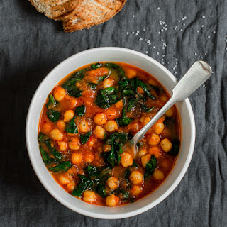 Moroccon Vegan Stew with Chickpeas, Sweet Potatoes, Raisins & Spinach.